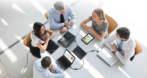 Business staff using video conference in a huddle space