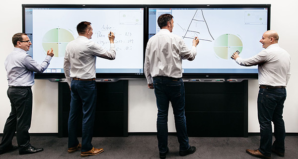 Smart whiteboard in use in a huddle space